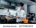 shot of two young cooks... | Shutterstock . vector #1075983305