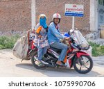 man and lady on a motorcycle ... | Shutterstock . vector #1075990706