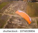 paraglider flying over nature.... | Shutterstock . vector #1076028806