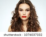 serious woman with red lips ... | Shutterstock . vector #1076037332