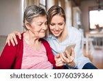 elderly grandmother and adult...   Shutterstock . vector #1076039366