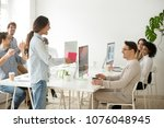 female colleague making... | Shutterstock . vector #1076048945