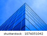 business building with mirrored ... | Shutterstock . vector #1076051042