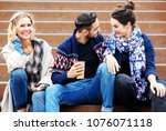 group of friends sitting... | Shutterstock . vector #1076071118