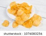 potato chips on white wooden... | Shutterstock . vector #1076083256