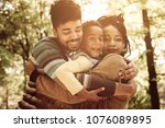 african american family hugging ... | Shutterstock . vector #1076089895
