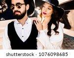 stylish wedding couple near the ...   Shutterstock . vector #1076098685