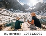 father and son hiking traveler... | Shutterstock . vector #1076123072
