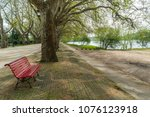 park bench in river side view... | Shutterstock . vector #1076123918