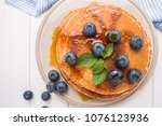 stack of pancakes with fresh...   Shutterstock . vector #1076123936