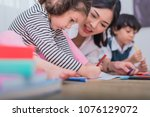 cute kids and asian teacher... | Shutterstock . vector #1076129072