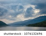 moody sky with stormy clouds... | Shutterstock . vector #1076132696