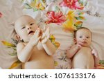 two funny siblings laying on... | Shutterstock . vector #1076133176