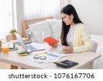 asian female freelancer reading ... | Shutterstock . vector #1076167706
