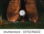 the wrist watch is next to the... | Shutterstock . vector #1076196632