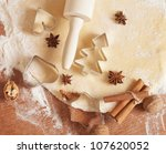 baking background with dough, spices and cookie cutters - stock photo