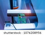 pcb processing on cnc machine... | Shutterstock . vector #1076208956