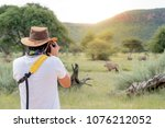 young man traveler and... | Shutterstock . vector #1076212052
