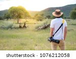 young man traveler and... | Shutterstock . vector #1076212058