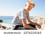teenager tourist male relaxing... | Shutterstock . vector #1076224265