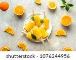 homemade popsicles with orange... | Shutterstock . vector #1076244956