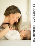 young mother smiling and... | Shutterstock . vector #1076264468