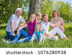 smiling multigeneration family... | Shutterstock . vector #1076280938