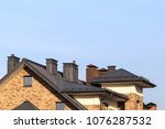 metal roof of a brick house... | Shutterstock . vector #1076287532
