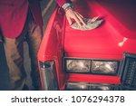 buying pre owned car. men... | Shutterstock . vector #1076294378
