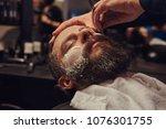 bearded male sitting in an... | Shutterstock . vector #1076301755