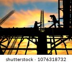 silhouette construction workers ...