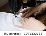 hands of woman working on the... | Shutterstock . vector #1076333396