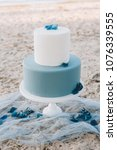 blue two tiered wedding cake on ... | Shutterstock . vector #1076339555