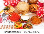 Russian Shrovetide meal - pancake with caviar and tea - stock photo