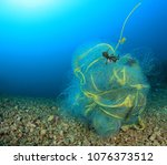 ghost fishing net pollution of... | Shutterstock . vector #1076373512