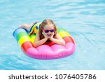 happy child on inflatable ice... | Shutterstock . vector #1076405786