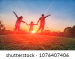 family silhouette with sunset   ... | Shutterstock . vector #1076407406