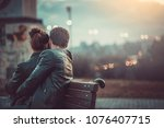 Young Sweet Couple Embraced On...