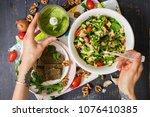 woman hands holding vegetable... | Shutterstock . vector #1076410385