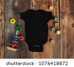 Mockup Flat Lay Of Black Baby...