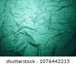 green wrinkled paper light... | Shutterstock . vector #1076442215