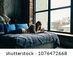 attractive woman with book... | Shutterstock . vector #1076472668