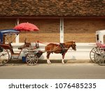 horse carriages and old brick... | Shutterstock . vector #1076485235