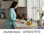 woman in a turquoise shirt... | Shutterstock . vector #1076517572