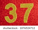 Small photo of Number thirty-seven yellow color over a red background. Anniversary. Horizontal