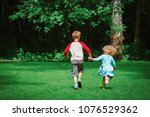 little girl and boy run play in ... | Shutterstock . vector #1076529362