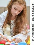 lovely child girl playing dough ... | Shutterstock . vector #1076556695