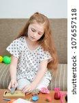 lovely child girl playing dough ... | Shutterstock . vector #1076557118