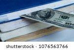 banknotes insert in stack of...   Shutterstock . vector #1076563766