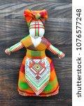 motanka doll on the wooden... | Shutterstock . vector #1076577248